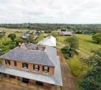 Aerial shot looking over the top of the house towards the stables and other outbuildings.