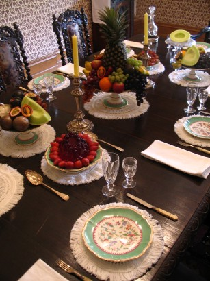 The table set for dessert – with fruits including pineapples, grapes, melons, Cavendish bananas and tamarillos.