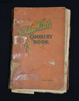 The well used front cover of The Golden Wattle Cookery Book