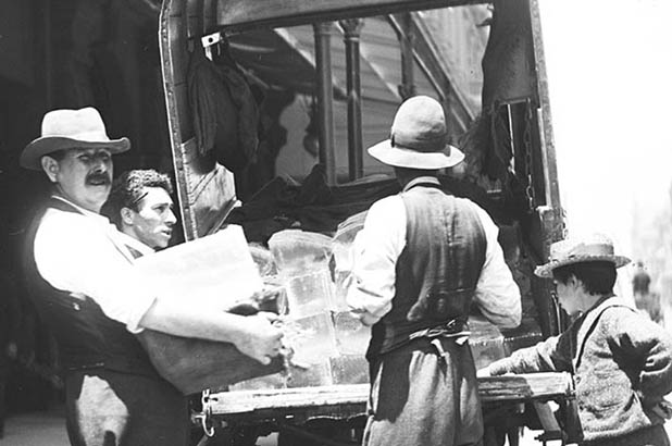 Detail of a photograph showing blocks of ice being delivered.