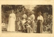 Photograph of Robert 'Bob' Barnet in uniform, with the Thorburn sisters and Elgin Macgregor in the garden at Meroogal, Nowra, 1916.