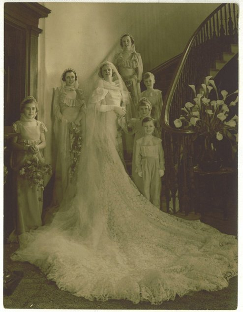Photograph showing bride, musical comedy star, Madge Elliot, and bridal party on the saloon stair at Elizabeth Bay House