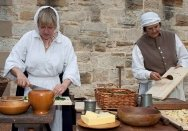 Two women cooking at 'Redcoats and Convicts' at Hyde Park Barracks.
