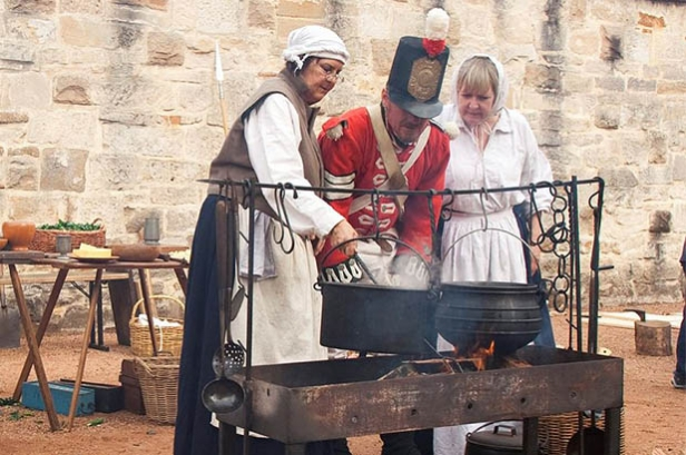 Cooking over the fire at 'Redcoats and Convicts' at the Hyde Park Barracks.