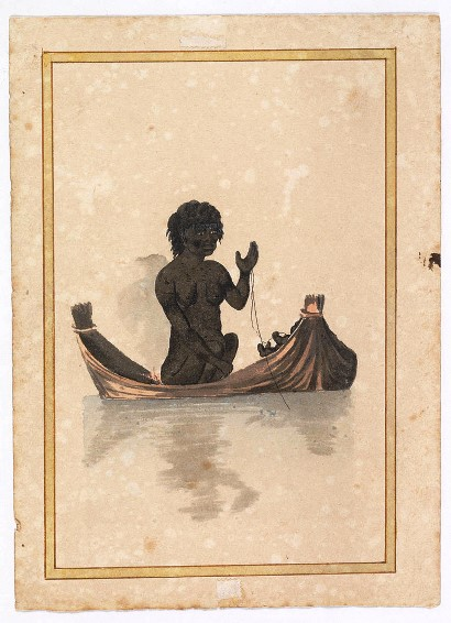 Aboriginal woman in canoe fishing with a line