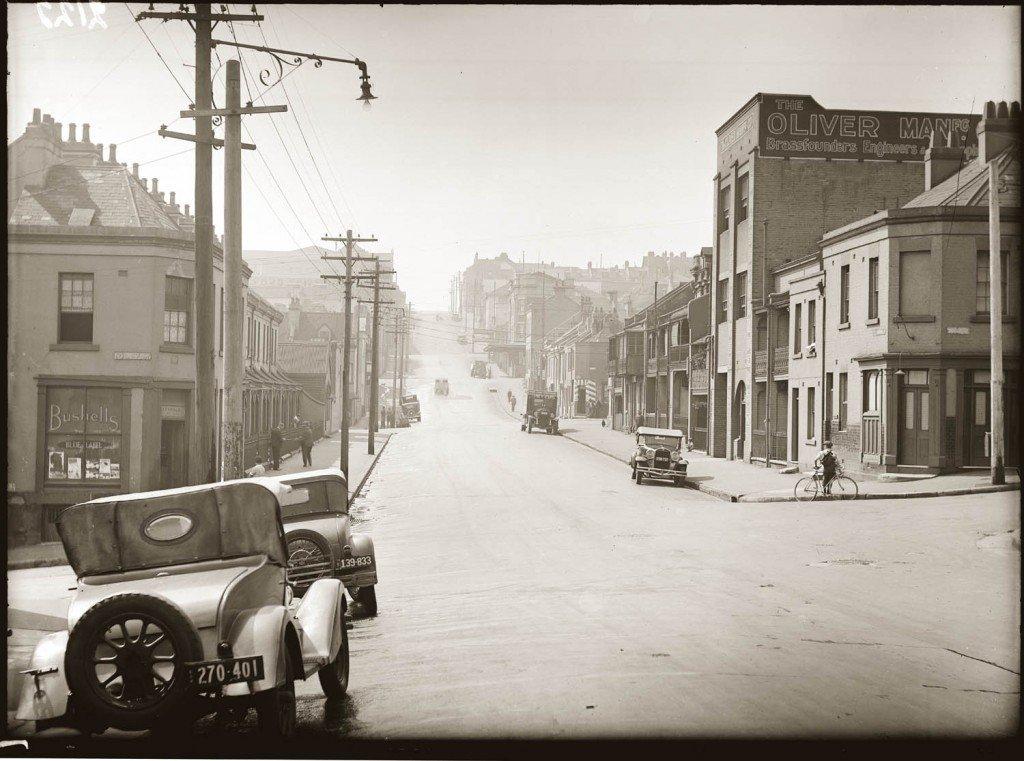 Street scene, Liverpool Street, Darlinghurst, near corner of Riley Street, looking east, around 1938.