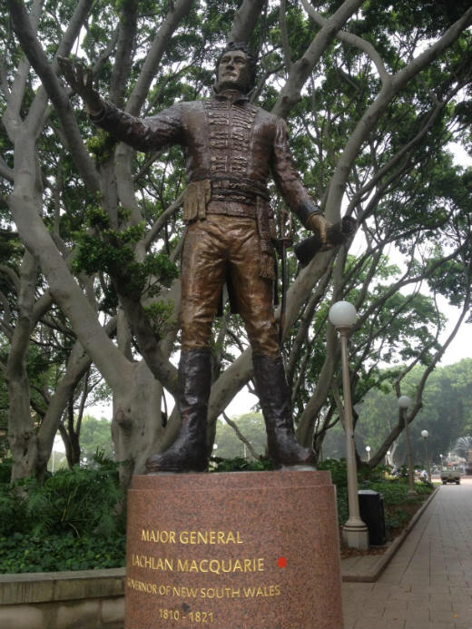 Statue of Governor Macquarie with red dot sticker