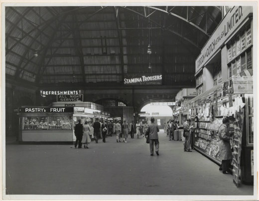 "There was much more advertising in the concourse in 1958 than there is today. The advertisements complement each other, although I don't know if this was intentional: wine, analgesics (Vincent's APC), and Stamina ""self supporting"" Trousers."