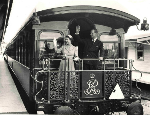 Queen Elizabeth II and Prince Phillip on the royal train at Central Railway Station, 1954.