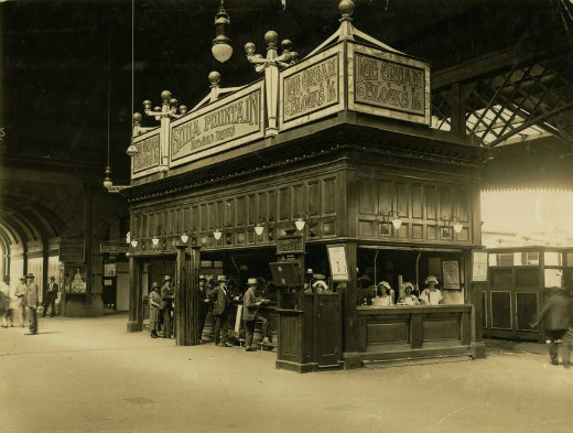The concourse soda fountain, around 1920. If you look closely you will see that everyone in this photograph is wearing a hat.